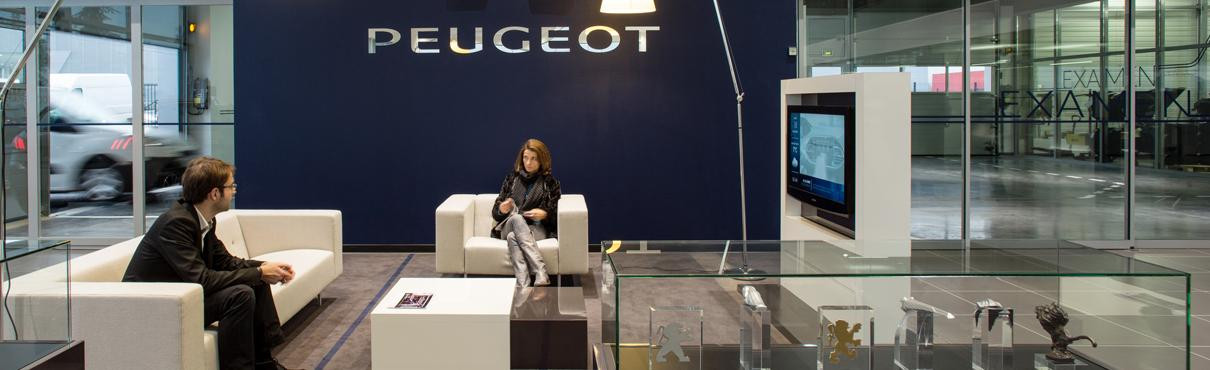 Customers in Peugeot showroom