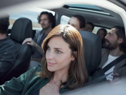 Friends driving in Peugeot 5008 SUV